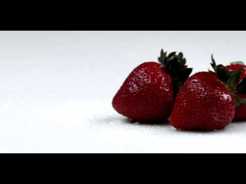 Royalty Free Stock Footage of Panning across strawberries.