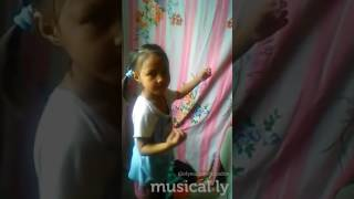 This little girl try to do the musical.ly style
