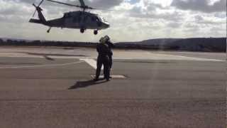 Directing a Navy Helicopter (Landing Signalman Enlisted)