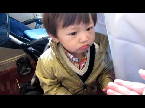 Zade eating sesame ball June, 2011