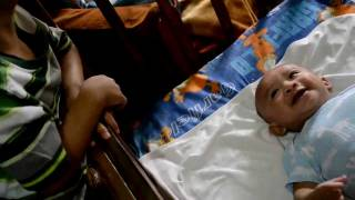 big brother SeDi amuses baby Ely
