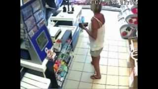 Dramatic video Corner shop worker fends off armed robber
