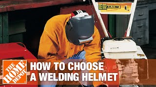 A person wearing a welding helmet while welding