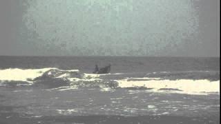 boat crashing into waves