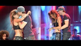 Enrique Iglesias besa a novia de piloto Hamilton en pleno concierto