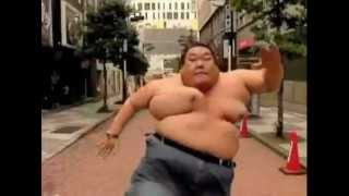 Fat guy runs shirtless in slow-mo width=