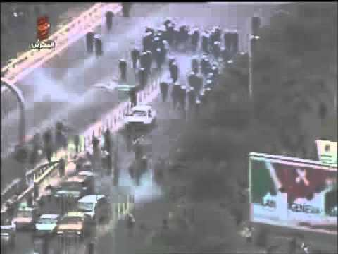 Terrorists in Bahrain blocking the roads early morning Sunday 13 March 2011.flv