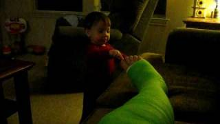My son tickles my toes in my cast