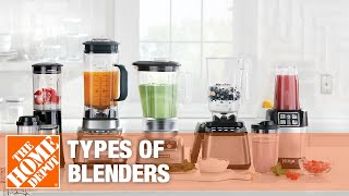Three different kinds of blenders, filled with different foods, sitting on a counter.