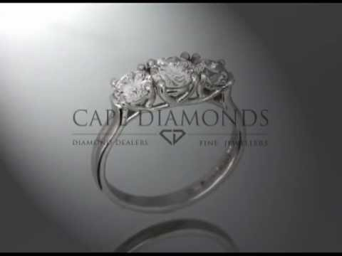 3 stone ring,round diamonds,4claws each,platinum,engagement ring
