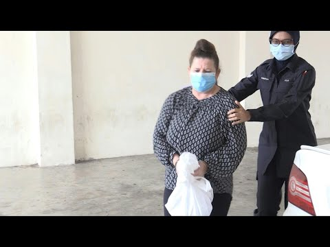Malaysia: British woman accused of murdering husband arrives at court | AFP