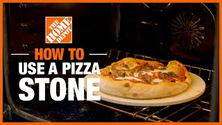Pizza baking in oven on a pizza stone