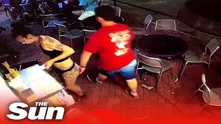 Waitress tackles customer who SLAPS her bum