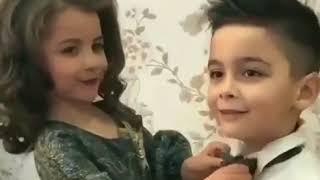Small boy kiss the girl width=