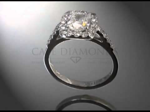Complex stone ring,round diamond,cushion diamond base,4 round diamonds each side,engagement ring