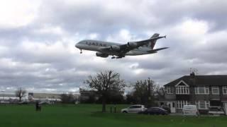 vid86 Qatar a380 over houses  Plane spotting Heathrow Heavies in strong wind   15nov15 1241p