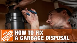Garbage disposal under a sink.