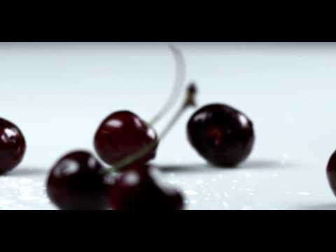Royalty Free Stock Footage of Cherries dropping onto a table.
