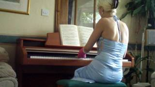Cheryl plays the piano in an arm and leg cast.