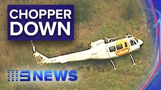 Water bombing helicopter crashes to the ground | Nine News Australia