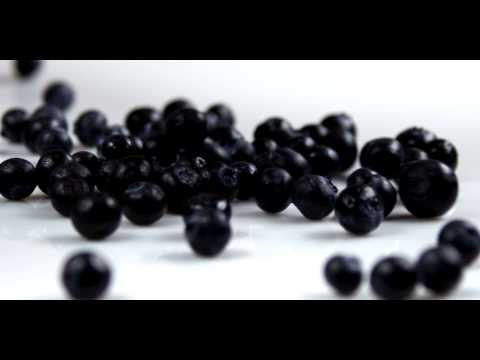 Royalty Free Stock Footage of Clip of blueberries falling onto a table.