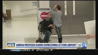 Airman surprises girlfriend with homecoming proposal