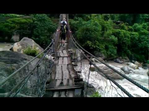 Nepal Trekking – Crossing A Bridge