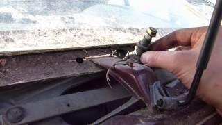 Comment démonter le moteur d'essuie glace sur Citroën AX