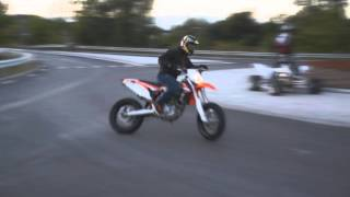 KTM 450 supermoto powerslide drift in traffic circle