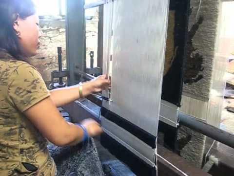 Tibetan Refugee making a carpet