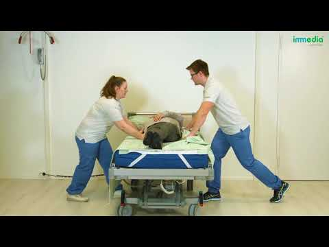 Turn the patient on their side using 4Direction DrawSheet Maxi