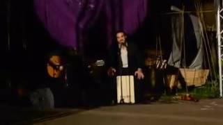 Spanish flamenco musician singer guitarist performs Beatles classic