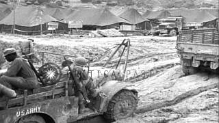 Command vehicles and 3/4 ton Dodge weapons carriers move through mud in Ryukyu Is...HD Stock Footage