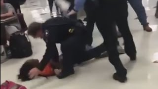 Activists want officer fired over school fight actions