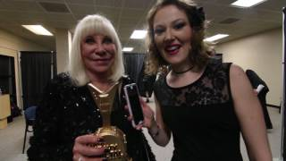 Ronnie Dio's wife, Wendy, accepts his award at the Hall of Heavy Metal Fame