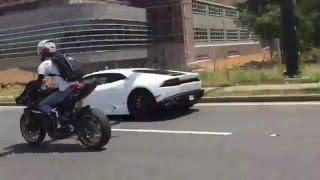 2015 Lamborghini Huracan races a biker gang