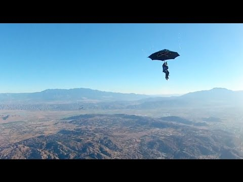 Jumping from an airplane with an umbrella instead of a parachute