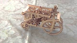 Ukrainian wooden mechanical tractor toy